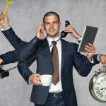 Business Man Multi-Tasking With Clock Practising Good Time Management Skills